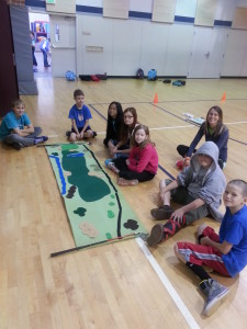 Kids learning what a golf hole looks like - Options School